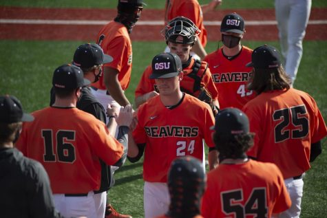 Nathan Burns and the rest of the Oregon State Beavs return to the dugout after a hard inning against University of Oregon Ducks on March 13, 2021. Burns was the 561st overall draft pick and was selected by the Los Angeles Angels.
