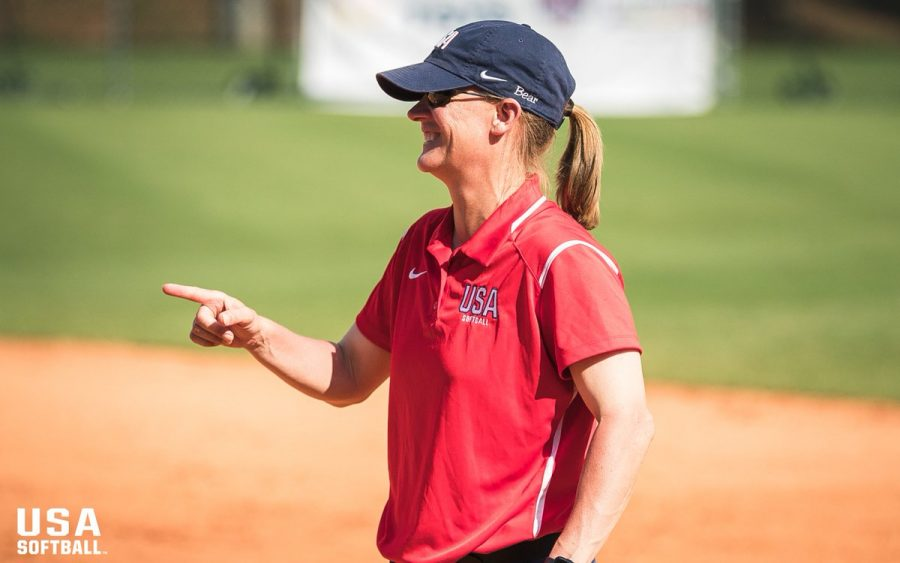 Laura Berg, head coach of the OSU Softball team, can be seen on the field. In Tokyo in July, Berg won silver in the 2020 Olympics—her fifth Olympic medal.