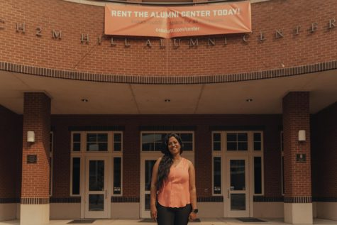 Alumni Association Early Engagement Director Mamta Chowdhury in front of the Alumni Center. The Association provides graduating students with many resources, including connecting them with post-graduates who can provide their expertise.