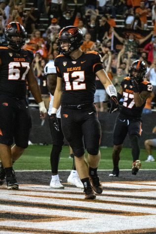 Redshirt-junior inside linebacker Jack Colletto pictured in the endzone against the Hawaii Rainbow Warriors. Against the Trojans, Colletto scored 2 rushing touchdowns, and 1 interceptions to help the Beavers defeat the Trojans, 45-27