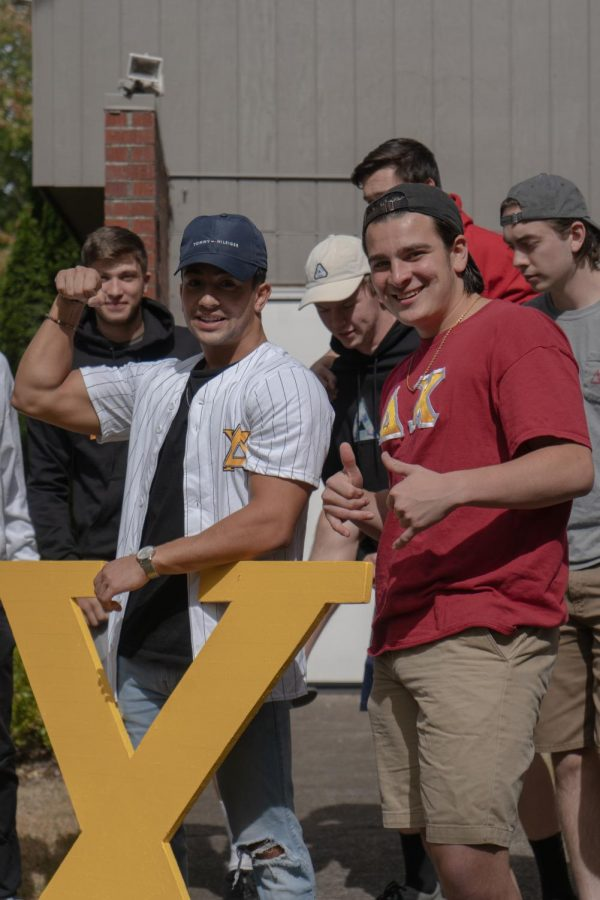 Delta Chi members prepare for rush week and the influx of recruits in front of their house. They are excited to return to in-person events and activities with their fraternity brothers.