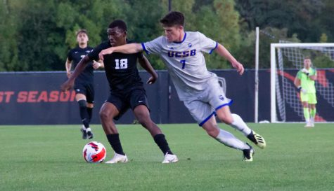 Beaver senior midfielder Tyrone Ntsabeleng fights to maintain possession of the ball from the opposing midfielder Sam Fletcher of UC Santa Barbara. Only moments later Ntsabeleng would be laying on the field from suffering a minor injury.