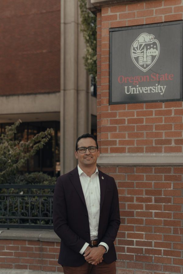 Scott Vignos stands before an Oregon State University sign near the Kerr Administration building, where the Office of Institutional Diversity is located. Vignos is now leading the OID as the new interim vice president and chief diversity officer as of Sept. 20.