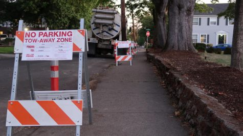 Construction signs located on 25th Avenue which blocks parking for both the Delta Upsilon Fraternity and the apartment complex directly across the street from Delta Upsilon. With parking being restricted on the next street over, parking has become increasingly less available.