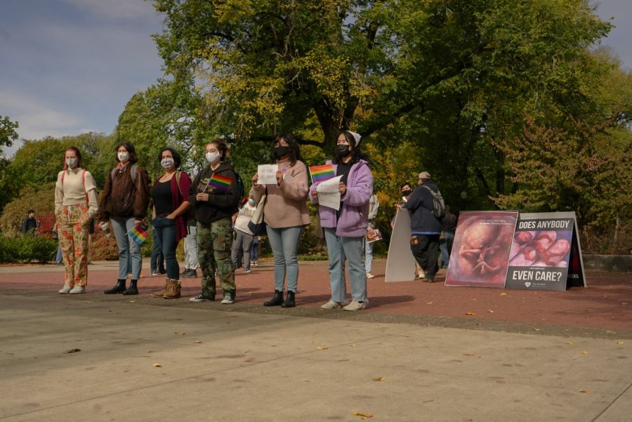 """OSU students from across campus protested against the viewpoints of the anti-abortion demonstration at the SEC plaza on Oct.12. When the Tiny Heartbeat Ministries left campus, pro-choice protestors followed while chanting """"pro-choice."""""""
