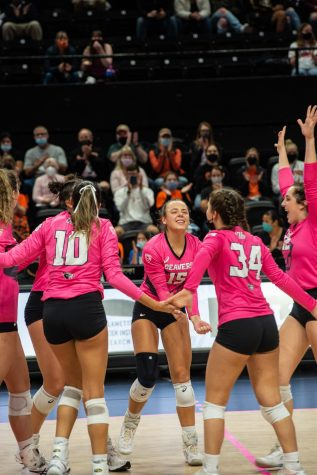 The OSU volleyball team celebrates after scoring a point in the game versus the Washington State Cougars on Oct. 15. The Beavers would go on to lose the game, 0-3.