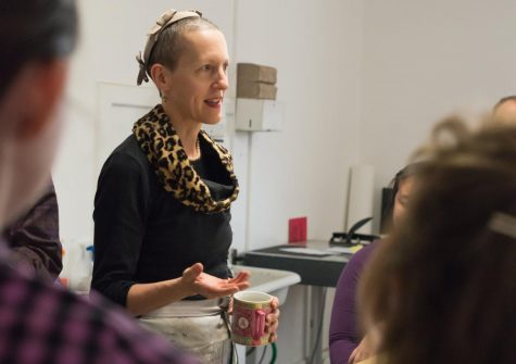 Oregon State University Professor Julie Green teaches a class while drinking their favorite green tea. Green taught painting to advanced students in the BFA program at OSU.