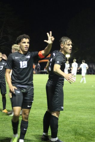 Junior midfielder Sofiane Djeffal, (left), and junior defender Gael Gibert signal to nearby teammates after they scored the final point that put them in the lead against UCLA at Thursday nights game.