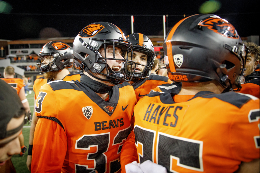 Members of the Oregon State football team are seen here congratulating sophomore kicker Everett Hayes. Hayes hit the game-winning field goal against the Washington Huskies on October 2, 2021.
