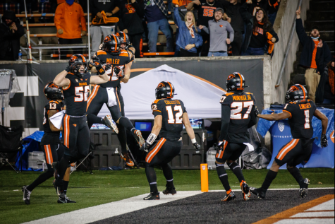 The Oregon State football team celebrating sophomore tight end  Luke Musgrave blocking a punt returned for a touchdown against the University of Utah Utes on October 24 at Reser Stadium. The Beavers would go on to defeat the Utes by a score of 42-34, getting their fifth win of the season.